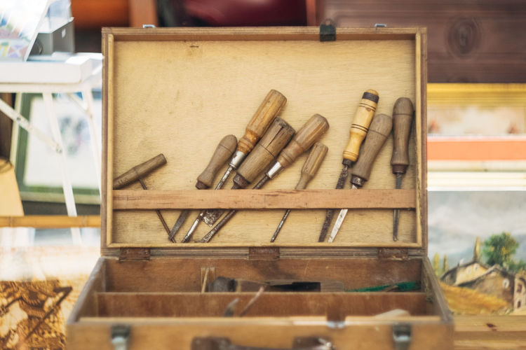 Close-up of wooden toolbox on table