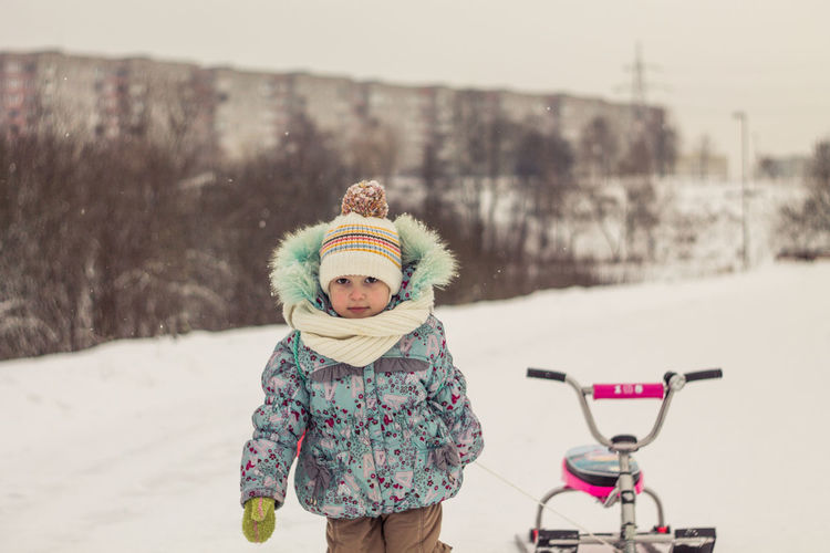 Clothing Winter Warm Clothing One Person Childhood Cold Temperature Child Real People Women Transportation Nature Females Looking At Camera Portrait Hat Focus On Foreground Day Outdoors Snow