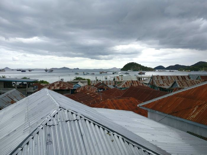 Rooftop. Fishing Village Fishing Town Rooftops Indonesian Labuanbajo Corregated Steel Metal Roof Metal Town Boats Port Sea Water Sky Cloud - Sky Overcast TOWNSCAPE Rooftop Residential Structure Residential District Old Town Housing Settlement Place Shore