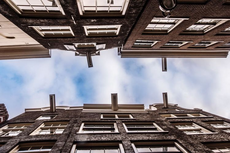 Dutch Houses in Amsterdam Enclosed Narrow Street Narrow Gable Roof Façade Dutch House Architecture Built Structure Building Exterior Cloud - Sky Sky Low Angle View Day Building No People Tall - High Directly Below Residential District Outdoors Roof Office Building Exterior City Window