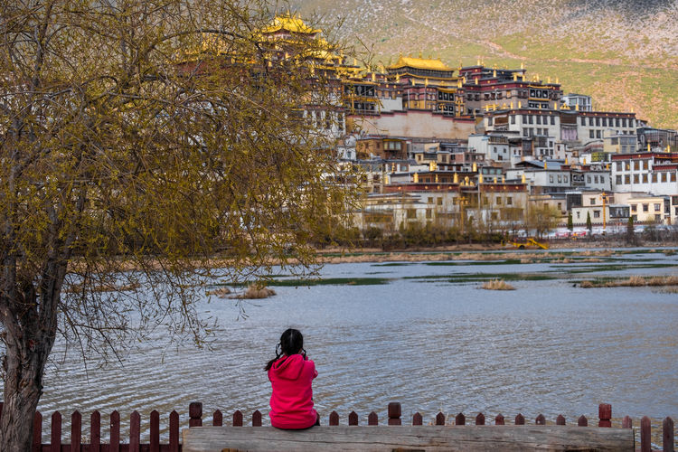 Architecture Building Exterior Built Structure Rear View City Real People Tree Water Lifestyles Women Building Nature Plant People Day Residential District Leisure Activity Men Outdoors Looking At View Temple Shangrila Shangri-La Yunnan China Tibet Religion Mountain