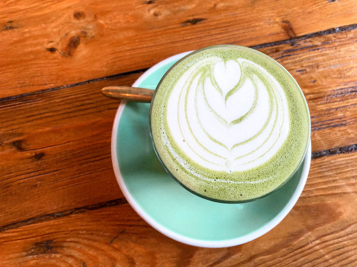Matcha latte Matcha Matcha Lattee Latte Green Tea Latte Healthy Drinks Food And Drink Refreshment Drink Frothy Drink Still Life Cup Froth Art Mug Wood - Material Coffee Cup Table Freshness Hot Drink Saucer Cappuccino Indoors  Crockery No People Non-alcoholic Beverage