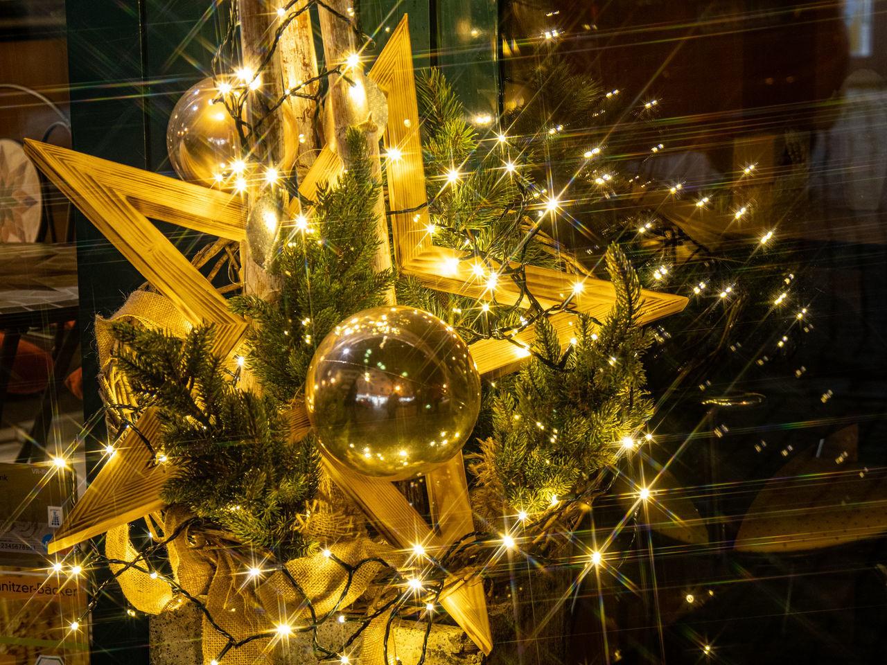 illuminated, decoration, celebration, christmas, holiday, christmas decoration, night, lighting equipment, christmas lights, holiday - event, no people, tree, glowing, christmas ornament, christmas tree, celebration event, hanging, low angle view, light, electricity