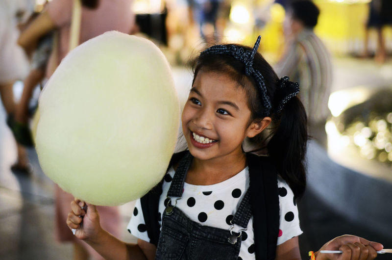 Close-up of girl holding cotton candy