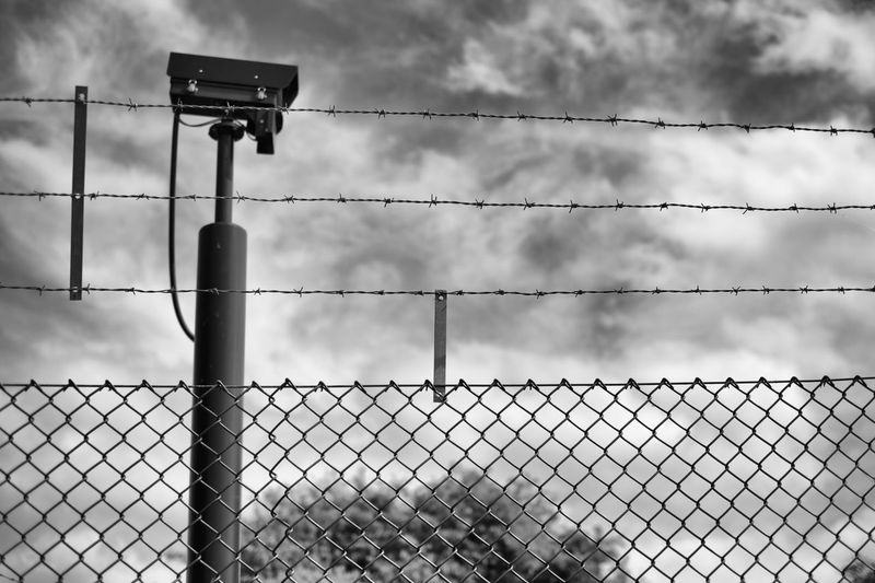 Barbed Wire Fence And Surveillance Camera
