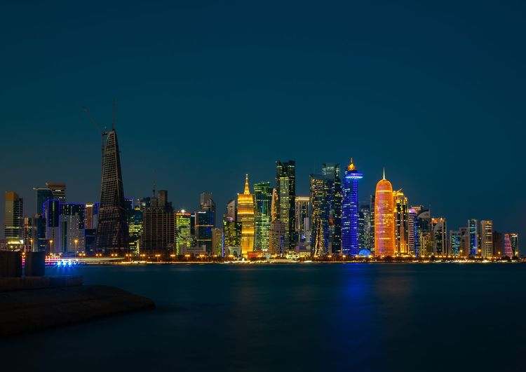 Doha Skyscrapers, State of Qatar Qatar Middle East Gulf Architecture Building Exterior Built Structure Office Building Exterior Night Building Skyscraper Illuminated City Sky Urban Skyline Water Landscape Waterfront Modern Cityscape Travel Destinations Office Tower Tall - High