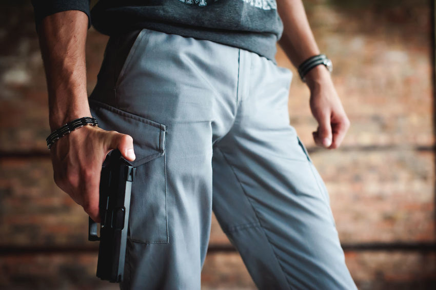 Gun Arrest Close-up Crime Day Focus On Foreground Holding Human Hand Men Midsection Outdoors Police Force Prisoner Real People Rear View Standing Weapon