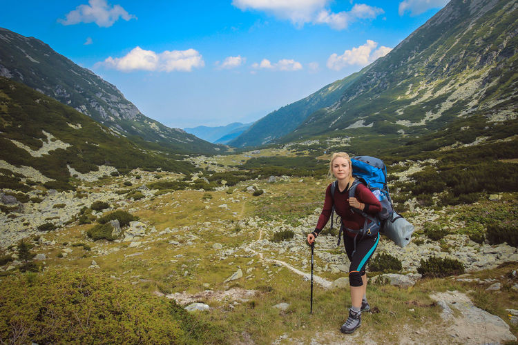 Retezat mountains Adventure Backpack Beauty In Nature Casual Clothing Cloud - Sky Day Full Length Healthy Lifestyle Hiker Hiking Hiking Pole Leisure Activity Lifestyles Mature Women Mountain Mountain Range Nature One Person Outdoors Real People Scenics Sky Standing Tranquil Scene Tranquility
