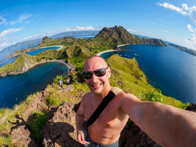 Padar Island, Indonesia Adult Beauty In Nature Fashion Front View Glasses Happiness Leisure Activity Lifestyles Looking At Camera Mature Adult Mountain Nature One Person Outdoors Padar Island Portrait Real People Scenics - Nature Smiling Sunglasses Water