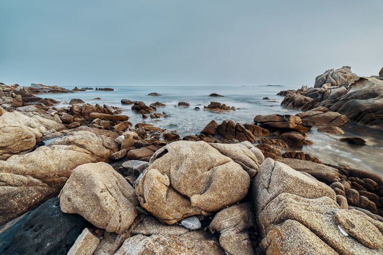 Rock Solid Sea Rock - Object Water Sky Beauty In Nature Scenics - Nature Land Beach Tranquility Nature Horizon Over Water No People Tranquil Scene Horizon Day Idyllic Outdoors Pebble Rocky Coastline