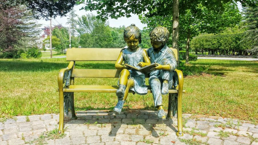 Sculptures At Park During Sunny Day