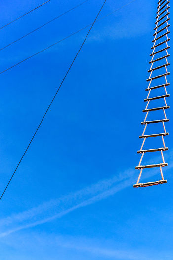 Blue Low Angle View Architecture Built Structure Sky No People Day Cable Construction Industry Nature Clear Sky Tall - High Technology Metal Industry Electricity  Tower Outdoors Copy Space Building Exterior Power Supply Ladder Construction Equipment