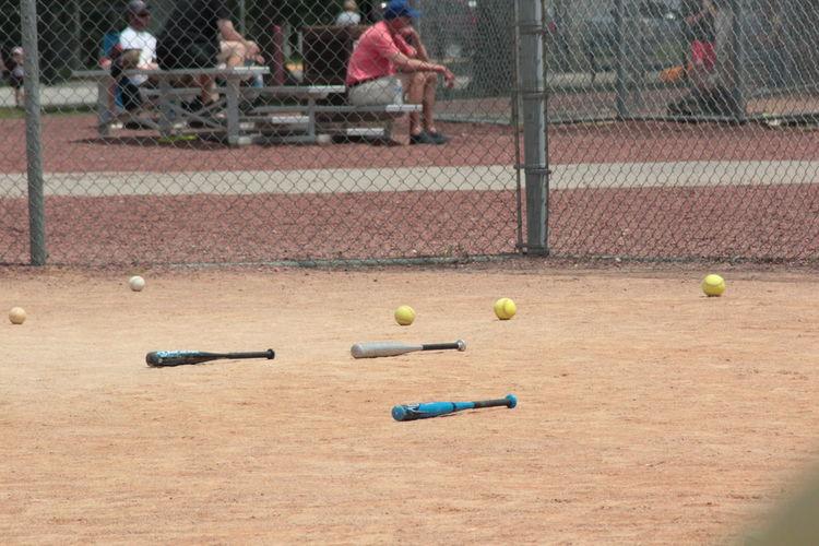 Baseball bats and balls on land
