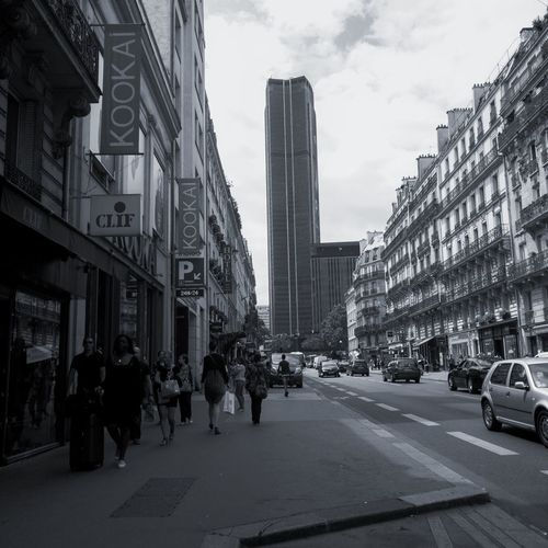 From Paris with Love Building Exterior Built Structure Street City Car Road City Life Large Group Of People Transportation Skyscraper Outdoors Day Real People Modern Sky People Streetphotography Street Photography Streetphoto_bw People Photography Blackandwhite Black And White Paris ❤