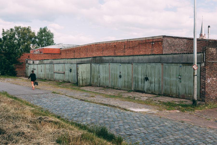 The Week On EyeEm Woman Alone Barefoot Suburbs Ghent Gent Belgium Garages Grunge Rotten Places Alone Walking