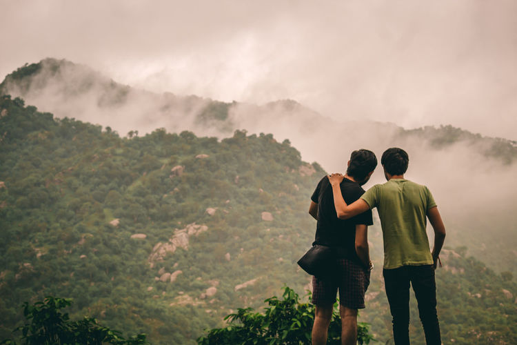 Rear view of friends looking at mountain