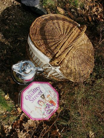High Angle View Outdoors No People Sunlight Text Close-up Day Quality Street Candies Candy Box Chocolate Box Life Is Like A Box Of Chocolates... Forest Ground Forestwalk Pic Nic Pic Nic Basket Pink Metalic Box Reuse NO WASTE Vintage Belgium