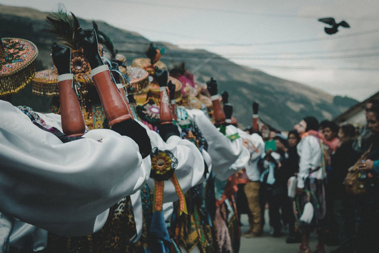 People in costume performing during festival