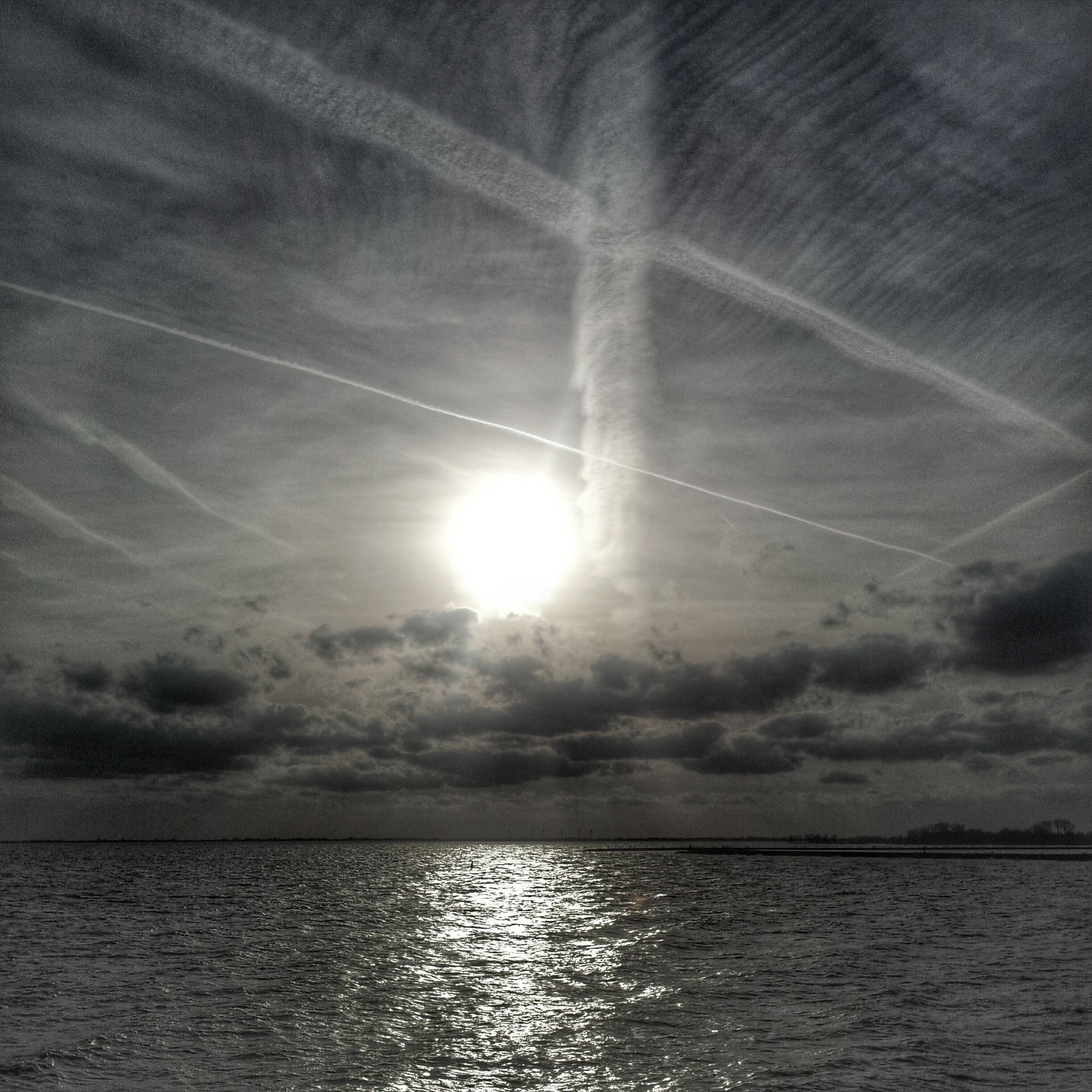 water, scenics, sun, tranquil scene, tranquility, beauty in nature, sky, sea, waterfront, reflection, nature, cloud - sky, sunlight, sunbeam, idyllic, horizon over water, sunset, cloud, outdoors, rippled