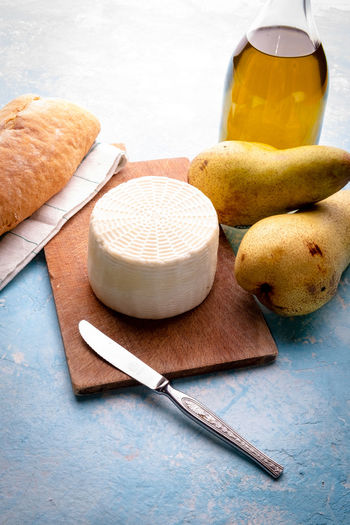 Fresh cow cheese with pears Food Food And Drink Freshness Still Life Wellbeing Indoors  No People Household Equipment Healthy Eating Cutting Board Table Wood - Material Container Close-up Bread High Angle View Eating Utensil Kitchen Utensil Kitchen Knife Studio Shot Table Knife Cheese Pears Fruit Olive Oil