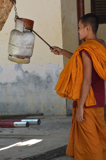 Monastery Bell Cambodia Dinner Bell Dinner Time One Person Only Religion And Tradition Buddhism Lifestylephotography Monk  Monks In Motion Monstery Young Adult