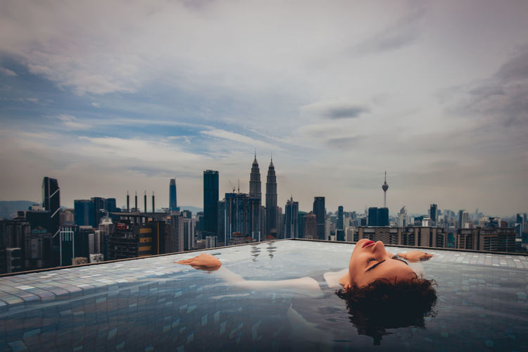 Architecture Building Exterior Built Structure City Cloud - Sky One Person Sky Water Real People Nature Leisure Activity Young Adult Lifestyles Building Cityscape Office Building Exterior Adult Women Outdoors Skyscraper Swimming Pool Infinity Pool International Women's Day 2019