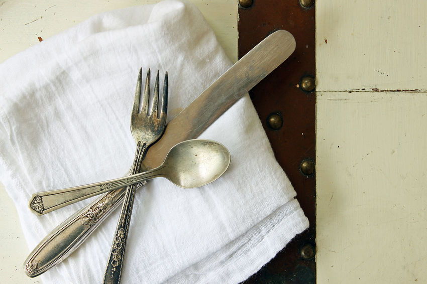 Table setting Above Backgrounds Close Up Concept Copy Space Cutlery Dinner Eat Elegant Food And Drink Fork Knife Meal Time Metal Napkin Old Rustic Silver  Spoon Table Setting Tarnished Vintage White Wood
