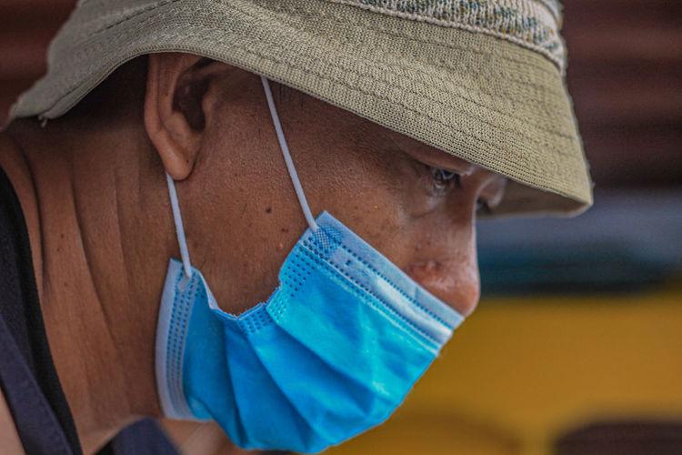 Woman wearing stylish protective face mask.accessory during quarantine of coronavirus pandemic.
