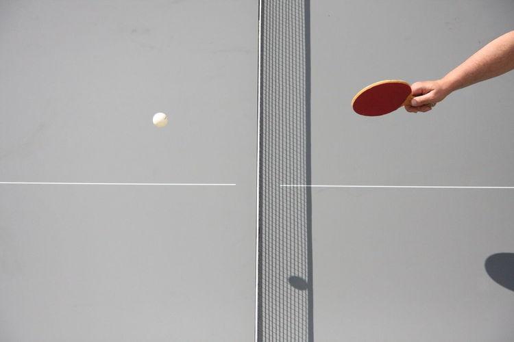 Cropped image of man playing ping pong