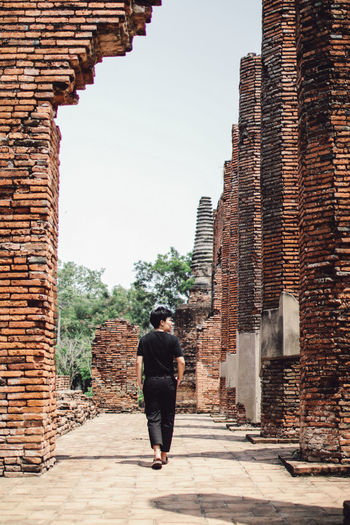 ayuthaya thailand - May 27,2019 : unidentified tourist walking in wat yai chaimongkol one of most popular traveling destination in ayuthaya world heritage site of unesco thailand Architecture Built Structure One Person Building Exterior Real People Full Length History The Past Lifestyles Leisure Activity Rear View Day Ancient Sky Travel Destinations Building Tourism Wall Travel Outdoors Brick Ancient Civilization Stone Wall Visit Ancient Adventure Architecture Culture Ayuthaya Religion Tourist Woman Religious  Travel ASIA Buddhist Thailand Buddhism Historical Landmark Ayutthaya Explore Discover Your City Traditional Vacations Photographer Heritage Worship Historic Destination