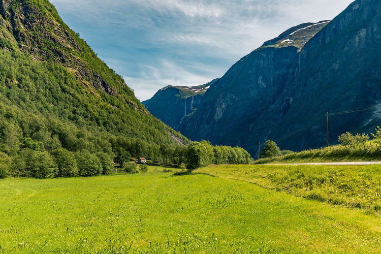 Beauty In Nature Canyon Day Grass Green Color Landscape Mountain Mountain Range Nature No People Outdoors Scenics Sky Stalheim Stalheimsklevia Tranquil Scene Tranquility Tree