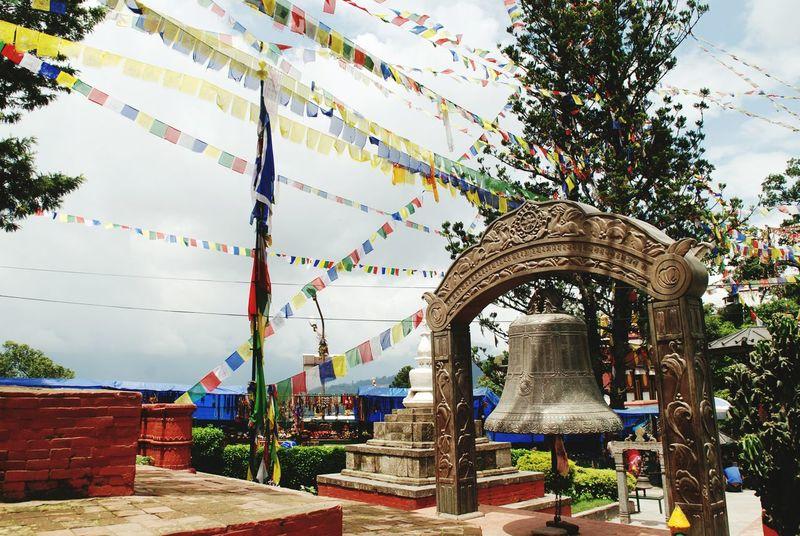 Tree Outdoors Architecture City Sky Day Prayerflagsnepal PrayerFlags Nopeople Kathmandu Nepal Buddhisttemple Buddhism Bell Naturelover Warm Colours Warm Travel Travelling Wanderlust Flags Monkeytemple Swayambhunath Swayambunath Stupa