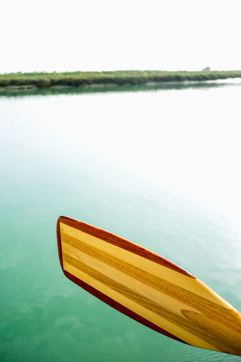 Kayaking In Nature River Ouse Second Acts Tidal River Tidal Wetlands Beauty In Nature Clear Sky Close-up Day Kayakingadventures Lake Nature No People Oars Ore Outdoors Paddle River Sky Tranquil Scene Tranquility Water Wooden Oar Wooden Paddle Yellow