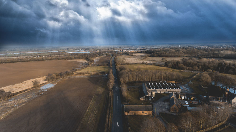 City Drone  Light Ray Rural Sky And Clouds Aerial Building Exterior Built Structure Clouds Crane Day Dji Landscape No People Outdoors Sky Skyscraper Sun Sunset Urban