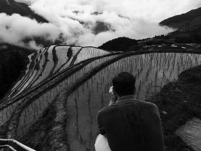 Beauty In Nature Cloud - Sky Day Leisure Activity Lifestyles Men Mountain Nature One Person Outdoors People Real People Rear View Rice Rice Terraces Sky Standing Water