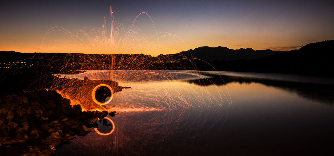 Fire fountain Beauty In Nature Illuminated Long Exposure Motion Mountain Nature Night No People Outdoors Scenics Sky Sunset Water Wire Wool