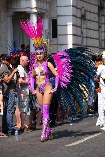 Dancer, London School of Samba Composition Feathers Fun GB London Looking At Camera Sunlight Capital City Carnival Carnival Costume Dancer Dancing Front View Full Frame Full Length Headdress Incidental People Nottinghill Carnival 2017 One Woman Only Outdoor Photography Performance Pink And Purple Colour Standing Uk Young Woman