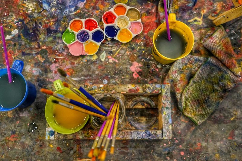 Art And Craft High Angle View Multi Colored Craft Still Life Brush Paintbrush Watercolor Paints Messy Palette Indoors  Art And Craft Equipment Choice No People Paint Creativity Table Nature Container