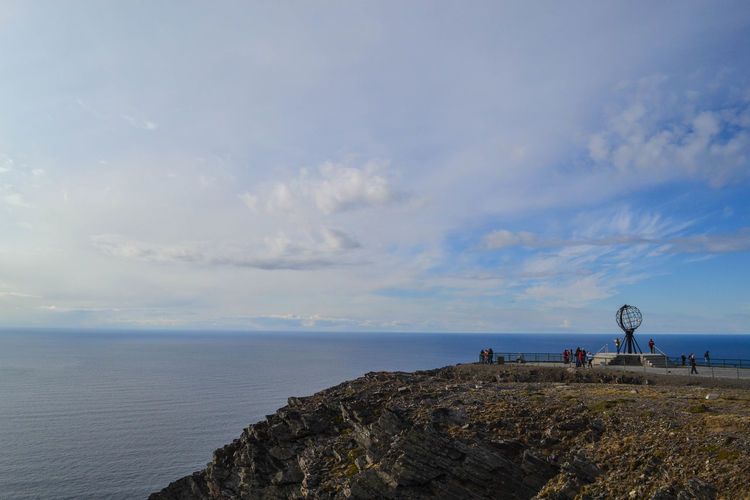 On the top of the world Cloud Coastline Europe Globe Horizon Over Water Idyllic Nature Nordkapp North North Cape Outdoors Rock Formation Sea Seascape Shore Sky Tourism Tranquility Vacations Water World