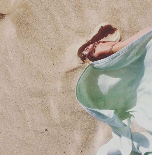 Womans Feet On Sand