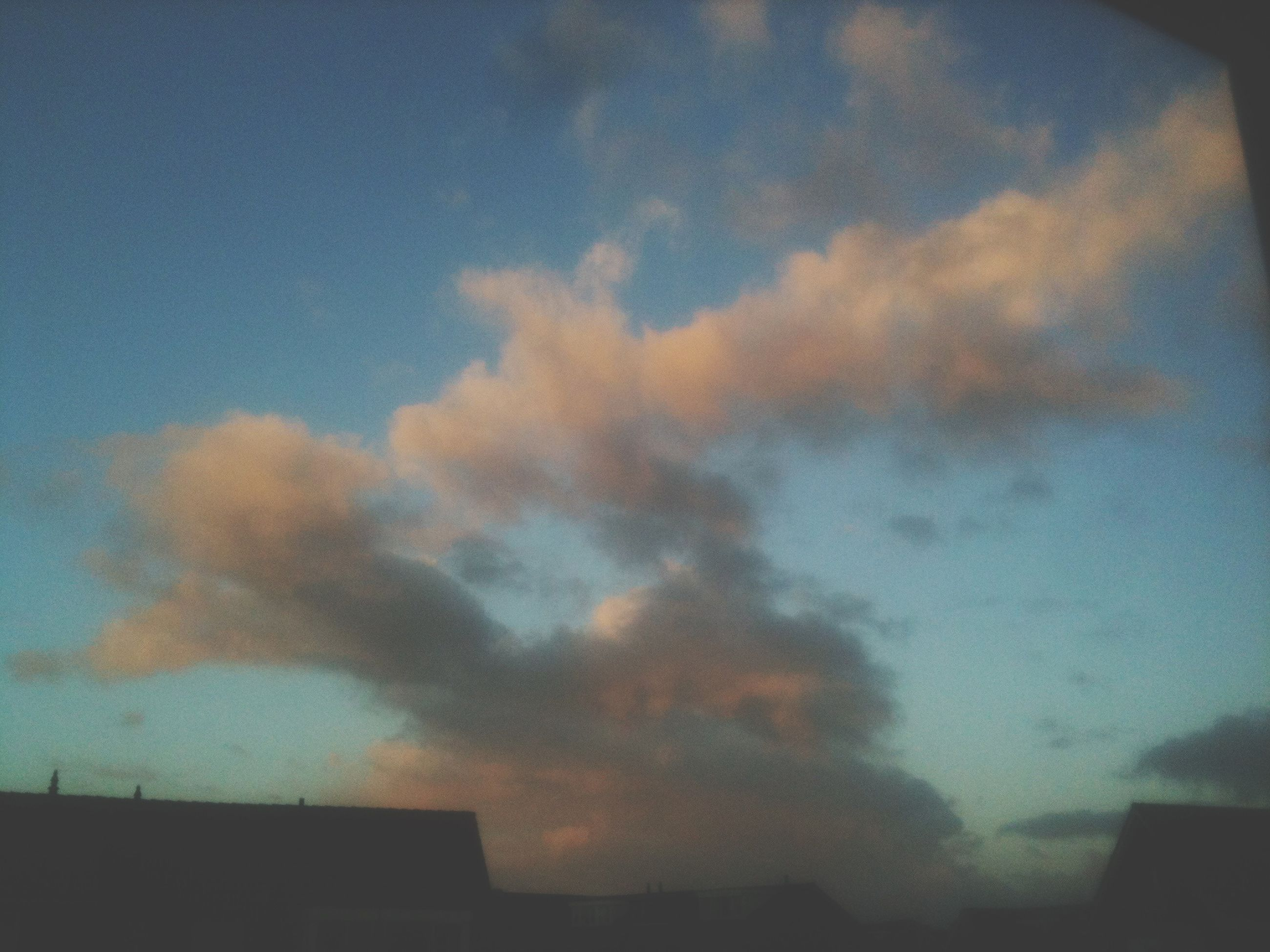 sky, cloud - sky, low angle view, cloudy, building exterior, architecture, built structure, weather, sunset, cloud, beauty in nature, nature, dusk, scenics, outdoors, no people, silhouette, house, blue, overcast
