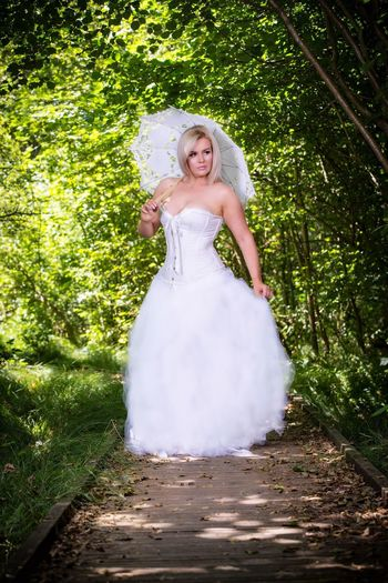 Wedding Dress Women Wedding One Person Plant Fashion Newlywed Celebration Bride Dress Event Young Adult White Color Adult Full Length Life Events Clothing Young Women Beautiful Woman Outdoors