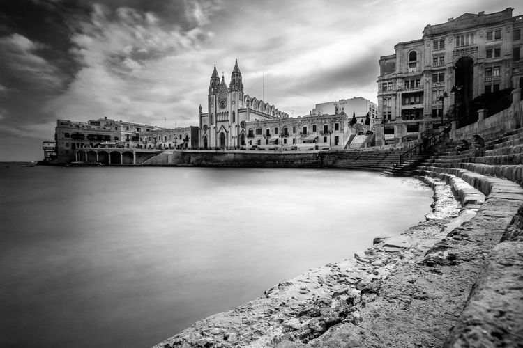 A nice view of St. Julien Bay, Malta Architecture Built Structure Building Exterior Sky Water Cloud - Sky Building Nature City Day No People Travel Destinations River Outdoors Travel Waterfront The Past History Long Exposure Church Blackandwhite Black And White Black & White Anfiteatro Stairs