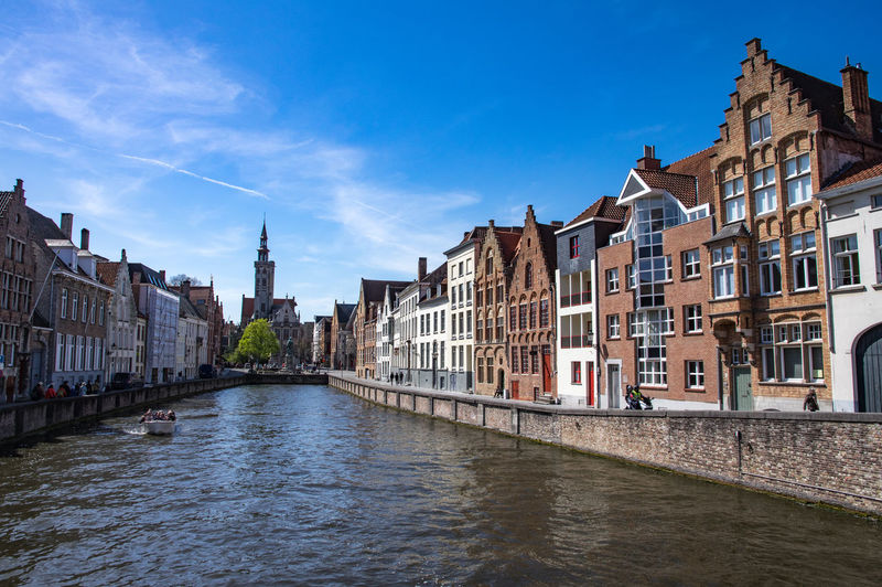 Belgium Brugge Architecture Building Building Exterior Built Structure Canal City Day Nature No People Outdoors Residential District Row House Sky Tourism Tower Travel Travel Destinations Water Waterfront