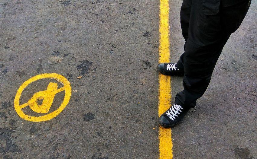 Man Standing On Road Marking