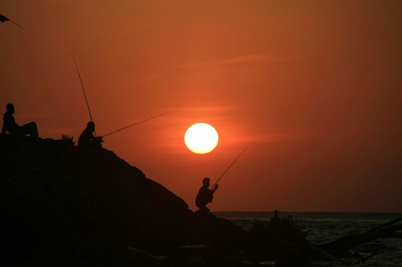 fishing sunset Aceh Culture Aceh INDONESIA Fisherman Fish Fishing Sunset Full Length Silhouette Adventure Men Standing Mid Adult Sky Camera - Photographic Equipment Half Moon Digital Camera Photographic Equipment Full Moon Moon Tripod Moon Surface Lens - Optical Instrument Digital Single-lens Reflex Camera Moonlight Photography Themes Photographing Camera Flash SLR Camera Camera Photographer