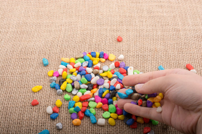 Little gravel pebbles in various colors Gravel Pebbles Human Hand Multi Colored People Real People Various Colors