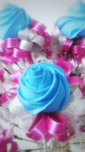 crepe paper rose Handmade Crepe Paper DIY Roses Bluerose Ribbon Glitter Beautiful Crepe Paper Multi Colored No People Pastel Colored Blue Candy Indoors  Sweet Food Close-up Day
