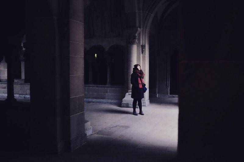 Full length of man walking in corridor at night