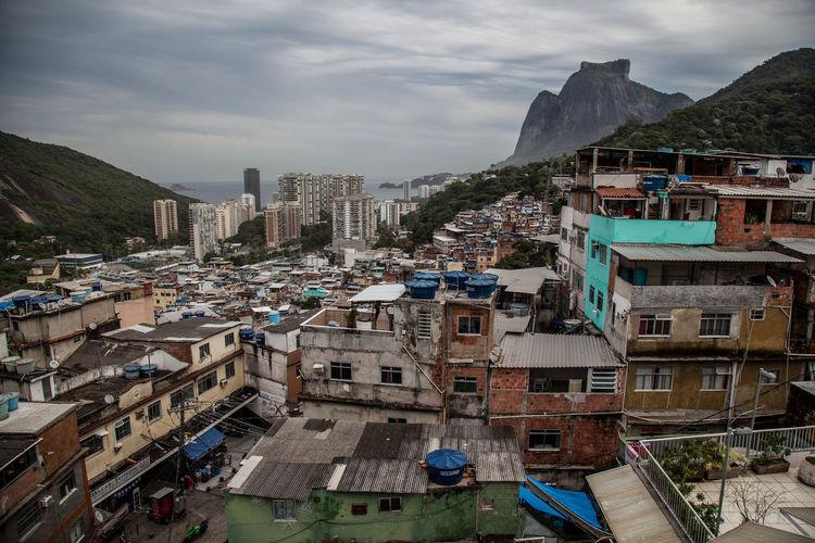 Houses, roads, mountains and places of favela Rocinha in Rio de Janeiro Brazil Colors Community Construction Houses RJ Rocinha Architecture Building Exterior Built Structure City Day Favela Nature Niemeyer Outdoors Sky Slum Tourism Town Windows